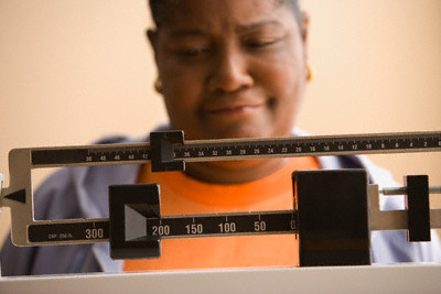 Woman.weighing.herself